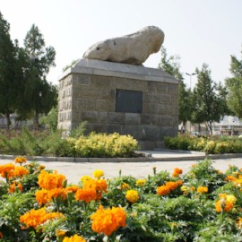 an ancient statue، iran travel agencies ،Iran tour packages، tour operators in iran